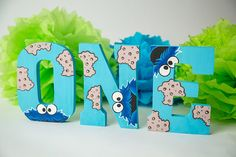 These adorable letters are the perfect addition to your little ones first birthday Cookie Monster party theme decorations, cake smash, prop, or photo shoot! Letters are hand painted with acrylic paints, wood and measure 7.75 inches in height ea. They are also predrilled in the back for easy hanging on the wall and are painted in blue on the back. They can stand upright on their own as well. Listing is for the letters ONE. If you desire your childs name painted in this theme and want to…