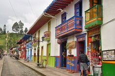 Salento, Colombia is in the heart of coffee region and is known for colorful doorways, charming locals, world-class hiking and an explosive game you'll never forget! Colombia Travel, Tropical Beaches, Green Mountain, In The Heart, Places To See, Travel Guide, Travel Destinations, Around The Worlds, America