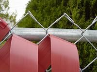 How to install privacy fence weave and fasten with plastic clips.