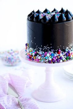 jet black icing with sprinkles for a fun Halloween cake