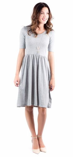 You'll exude all the grace and beauty of autumn's falling leaves in this beautiful dress.  It features short sleeves and an uber-soft heathered knit, and has pockets to make it the ultimate dress this season.  simple dress, grey dress, modest dress, fall fashion, women's fashion