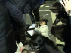 Riot police violently assaulting a defenseless professor