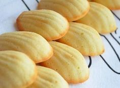 "French recipe for a lighter version of the ""Madeleines"", a typical French cake-style cookie Romanian Desserts, Romanian Food, Cooking Bread, Gourmet Cooking, Ww Recipes, Dessert Recipes, Cooking Recipes, Healthy Recipes, Pie Co"