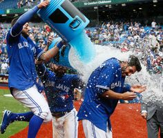 Chris Colabello of the Toronto Blue Jays is doused by Kevin Pillar and Russell Martin after driving in the winning runs in a victory over the Houston Astros on June 2015 at the Rogers Centre in Toronto Baseball Videos, Baseball Boys, Funny Baseball, Baseball Stuff, Softball, Baseball Cards, Blue Jay Way, Go Blue, Mlb Players
