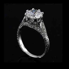 Perfect setting (found on eBay- $1,400/ setting only/ white gold - shown w/ 2 carat stone)