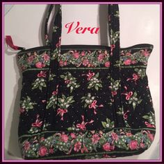 """Vera Bradley Bag Black with a multitude of pink bows and white/green flower arrangements with blue accents. Pre owned. Very good condition. Immaculate interior. 6 inside pockets. 3 pockets on the exterior with a hidden key attachment. Handle drop is approx 13"""" width 15"""" on top 11"""" bottom. Depth is 11"""". Shoulder bag/tote Vera Bradley Bags Shoulder Bags"""