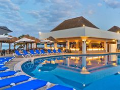 Sabor resort in Cozumel......adults only, all inclusive.....walk out the back door into a lazy river which takes you down a water slide down to the swim up bar!!!!