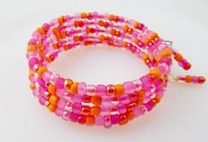 Hot Pink and Orange Memory Wire Bracelet/ Wrap Bracelet by PreciousPBoutique on Etsy https://www.etsy.com/listing/169274234/hot-pink-and-orange-memory-wire-bracelet