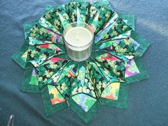 Patricks Day Shamrock Multi color with Rainbows Fabrics Centerpiece, Candleholder, fabric wreaths, Reversible, Fold n Stitch wreaths by AbbyLynns on Etsy Origami Candle Mat, Fabric Wreath, Centerpieces, Table Decorations, Green Fabric, Shades Of Green, St Patricks Day, Rainbows, Candle Holders