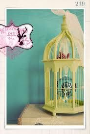 vintage ornament display. Make birdcages. Glittered thread for rungs