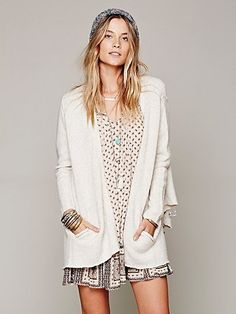 --- delicate print on a shirt dress with a cozy, oversized winter white sweater. Clean lines make it that much better.