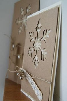 "❄Snowflake Card cut out of Kraft paper, layered with cream paper and tied with twine/jute cord. beautiful, but I would try different cut outs with colors, such as poinsettia cut out over red paper, Christmas tree over green paper (adding glittery ""snow"" on the branches). Also, a bell cut-out over vintage Christmas music. You could do this with other holidays, ❤too--so many possibilities!"