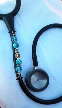 Vertical stethoscope ID charms with teal glass beads and can be customized with your name or designation