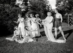 Denishawn dance company founder Ruth St. Denis and husband Ted Shawn with garden party guests (bridesmaids? caterers? vestal virgins?), among them modern dance pioneers   Louise Brooks and Martha Graham.