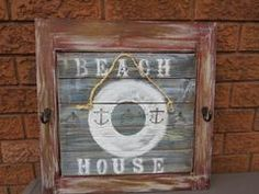 NATICAL DECOR/BEACH DECOR/RUSTIC GIFT IDEA   This item has been created with a vintage wood cupboard door and reclaimed barn wood. Finished in a nautical theme and painted in layers of chalk paint and stains, yet still showing the natural wood. Sealed with acrylic sealant.There are 2 hooks mid way up the cabinet frame.