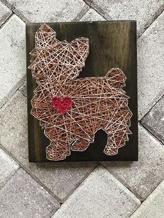 "MADE TO ORDER - Yorkie String Art Wooden Board This listing is for a - made to order - string art sign measuring approximately 7.25 x 9.25"". Boards will be stained dark walnut and strung with colors of choice! If you prefer a color, other than the one shown, please list color selection"