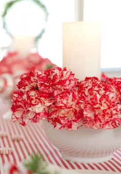 This easy red-and-white arrangement complements any Christmas table. More Christmas centerpieces: http://www.midwestliving.com/homes/seasonal-decorating/easy-christmas-centerpiece-ideas/?page=13,0