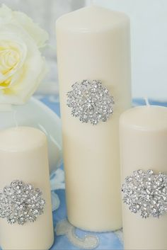 Make super stunning candles for your event tables with the Antique Starburst Rhinestone Brooch 407-S. Image from the Totally Dazzled Lookbook 2016