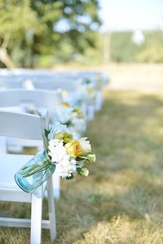 blue mason jars wedding ceremony decor for Rebecca and Max's wedding someday... with wild flowers or Daffodils