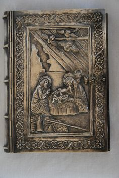 """ARMENIAN SILVER BINDING<br />  The Armenian Four Gospels, printed in Jerusalem in 1868. 10 x 6"""" in size, with a solid and very heavy beautiful silver binding on the front, back and spine. 275 and 81 pages. <br />  The front cover."""