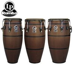"""NEW! Latin Percussion LP Rumba Mocha Finish 10"""", 11"""" & 12"""" Full Size Conga Set by Latin Percussion. $498.99. NEW! LP Rumba with Mocha Finish. The LP Rumba Series offers LP's very best in craftsmanship. Each drum has a classic, retro design with unique exterior bands that harken back to the days of the famous Palladium Dance Hall. The LP Rumba features 28"""" Tall Siam Oak Wood Shells, Hand Selected Natural Rawhide Heads, Traditional Black Rims, side handle for easy tr..."""