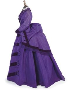 A PURPLE SILK DRESS, EARLY 1870S