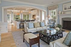 The flow of this space from one room to another is great and the color scheme is beautiful.