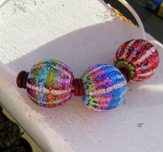 Big hollow Batik beads by Saffron Addict on Flickr and a link to her tutorial on Etsy.