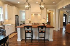 Yup....I love this color....it goes well with Antique White and its subtle......btw I LOVE those lanterns-RA   sw lattice kitchen | Calling all white cabinet lovers- what colors did you paint your ...