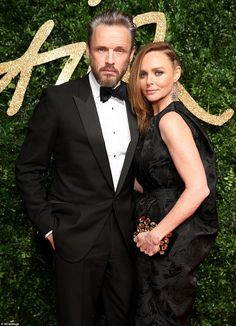 On the arm of her better half: The 44-year-old British designer was in attendance with her...