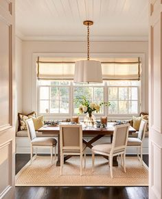 Full wall window seat in dining room