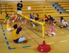 Sitting Volleyball: A Skill Enhancing and Physically Demanding Activity : NCHPAD - Building Healthy Inclusive Communities Adapted Physical Education, Physical Education Activities, Pe Activities, Youth Games, Pe Games, Games For Kids, Pe Equipment, Adapted Pe, Pe Ideas