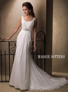 Maggie Bridal by Maggie Sottero Alma-22923    Style Number:Alma-22923  Maggie Sottero Bridal    This Paris Chiffon, slim A-line sheath captures the look and feel of a timeless romance. The ruched V-neckline features an embellished lace inlay and beaded motif with radiant Swarovski crystals at the empire waist. Finished with dramatic cowl back and covered button over zipper closure.