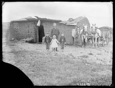 """""""Three motherless children and a caved-in soddy""""  George Barnes Family, Custer County, Nebraska"""