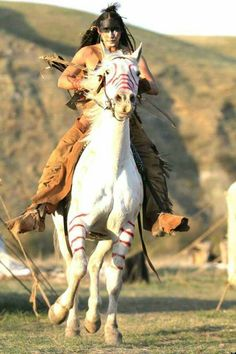 American Indian on decorated horse, the Lakota often painted horses and TeePees
