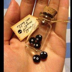 Mini glass bottle of soot sprites. #ghibli