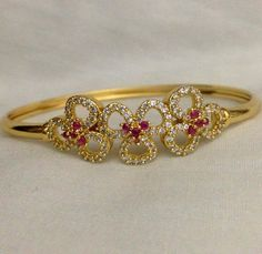 CZ and ruby stone flower model kada Code : BAK 380 Price : Whatsapp to for order processing. Plain Gold Bangles, Gold Bangles Design, Gold Earrings Designs, Bracelet Designs, Jewelry Design, Hand Jewelry, Simple Jewelry, Bridal Bangles, Bridal Jewelry