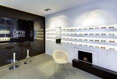 Optik Weiss by Heikaus, Aichtal – Germany Eyeglass Stores, Ceiling Draping, Open Fireplace, Retail Design, Store Design, Germany, Flooring, Eyewear, Optometry