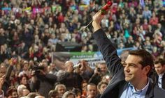 Alexis Tsipras, leader of the radical left main opposition party Syriza, greets supporters after a rally of the party in the northern Greek port city of Thessaloniki, January 2015.
