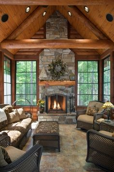 I really like how the tile looks here. I always thought we'd just stick with wood floors, but I'd love to see some options that would work well with the wood cabinets and wood ceiling. Cabin Fireplace, Fireplace Windows, Fireplace Stone, Fireplace Ideas, Log Cabins, Log Cabin Homes, Cabin Style Homes, Barn Homes, Huge Windows