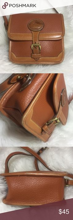 """Dooney Bourke Vintage Brown Small Crossbody Bag Dooney Bourke Vintage Brown Small Crossbody Shoulder Buckle Bag • 7""""w x 6""""h x 3""""d • Fold over flap w/ buckle closure • Interior has 1 zippered pocket & 2 slit pockets • Clean interior • 1 back slit pocket • Adjustable 0.75"""" wide strap • 20-22"""" drop • Cobblestone leather trimmed w/ leather • Wear is pictured: along bottom edges, strap has a 0.4"""" pen mark & 2 pencil eraser dark coloration stains, buckle tab has wear at the very end • Please feel…"""