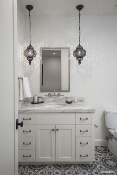 Guest Bath at SL3211.  Sabine Hill Concrete Floors, Jayson Home Pendants, Custom Millwork, Calacatta Marble, Rohl Plumbing Fixtures.  Designed by Michelle D. Young