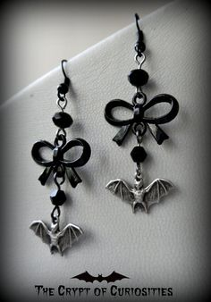 Gothic black crystal bat and bow dangle by TheCryptOfCuriositie