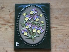This is a charming floral wall plaque in good condition. The measurement is 6 3/4 inch high and 5 1/4 inch wide   It is in good condition, see the