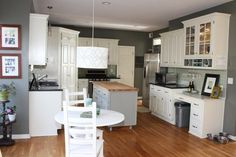 I think I like how they did this remodel. The white cabinets look nice with gray walls and (unexpected) wood floors!