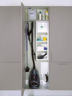 Cleaning closet storage cupboard for vacuum. The rest of the tall cupboards have large open space with a top shelf Cleaning Cupboard, Laundry Cupboard, Cleaning Closet, Cupboard Storage, Kitchen Storage, Kitchen Cupboard, Utility Room Storage, Laundry Room Organization, Laundry Storage