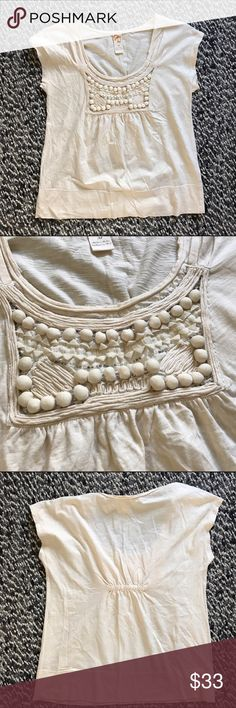 C. Keer white embellished t-shirt ✨ This is a beautiful top by C. Keer (an anthropologie brand) in women's size medium. It has a classy neckline and heavily decorated section that includes tiny, glassy beads and round fabric-covered pieces. The texture on this top is so rich and interesting, and surely makes this shirt drastically different than the other white tees you may have in your wardrobe! This shirt is gently pre-loved with only very light wear. Anthropologie Tops Tees - Short Sleeve