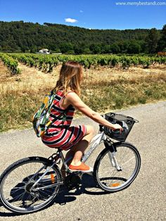 Rent a bike and cycle through the vineyards from village to village in Provence
