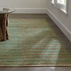 "Rustic undyed jute and soft teal-colored yarn are handwoven on traditional pit loomed to create a rug with exceptional texture and dimensional color.<br /><br />Order rugs (up to 6'x9') on-line and pickup in a <a href=""/stores/list-state.aspx"">store near you</a>. It's fast, easy and free.<br /><br />For 8'x10' and larger rugs, order on-line and arrange a convenient warehouse pick-up or delivery.<br /><br /><NEWTAG/><ul><li>Handwoven</li><li>75% jute, 20% rayon, 3% cotton and 2%…"