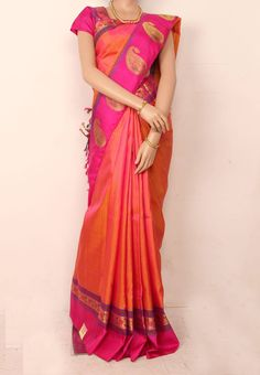 Parrot Green Colored Self Thread Butta Body with Magenta Pinkish Peach Colored Self Designed Pure Silk Saree and Pink Colored Jari Mango Butta Border. Pink Colored Blouse Part @ Rs.11190 http://www.shreedevitextile.com/women/sarees/silk-saree/shree-devi/pinkish-peach-colored-pure-silk-saree-1016